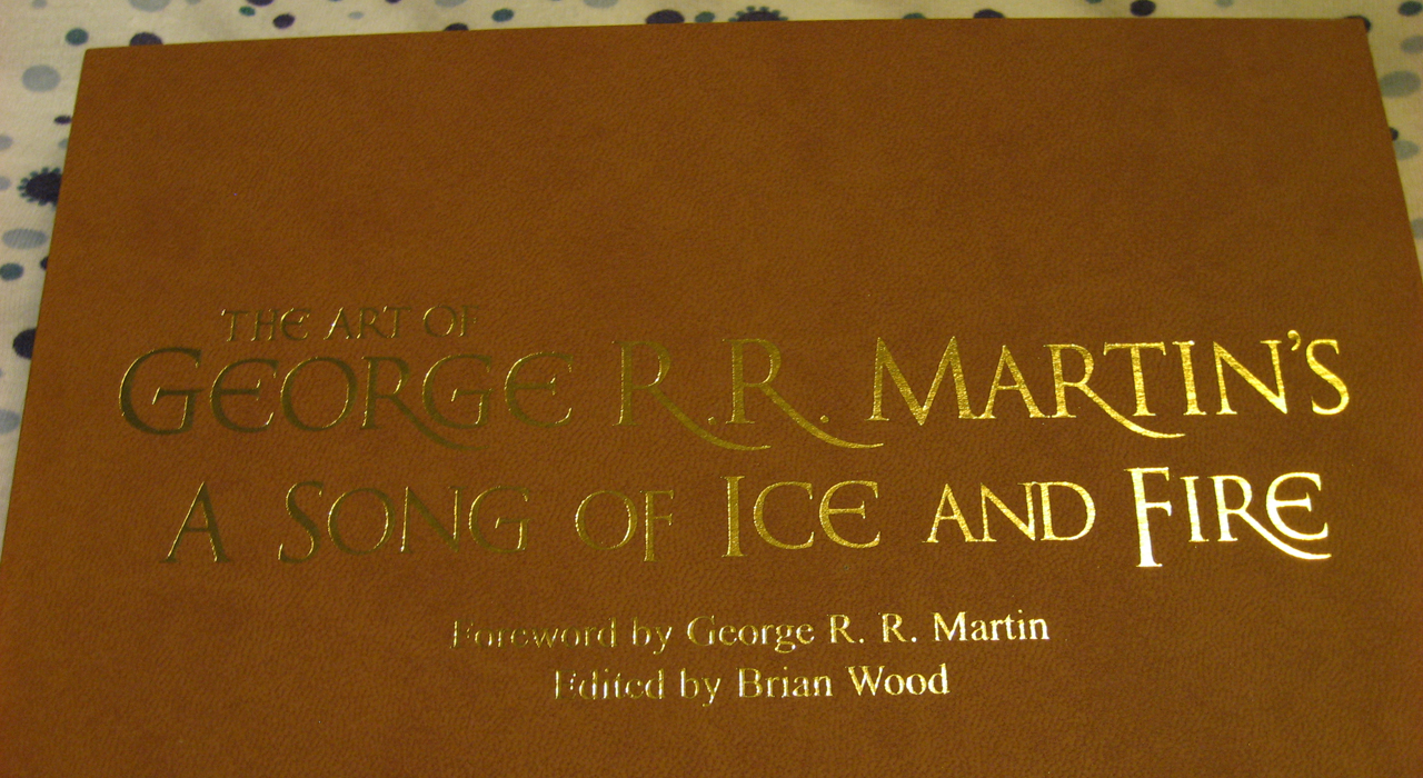 the art of george r r martin s a song of ice and fire a close up of the gold stamping on the slipcase